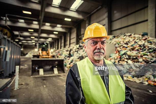 Portrait of the worker at the garbage dump