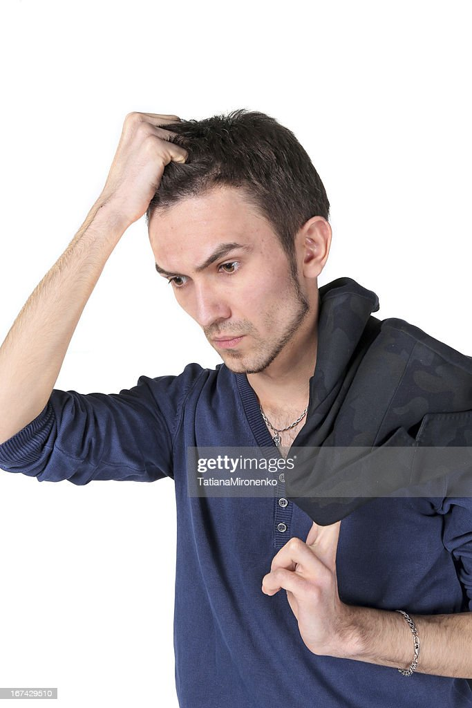 Portrait of  thinking young man : Stock Photo