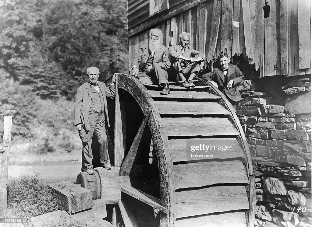 Portrait of Thomas Edison, John Burroughs, Henry Ford, and Harvey Firestone posing with mill, circa 1910. (Photo by Fotosearch/Getty Images).