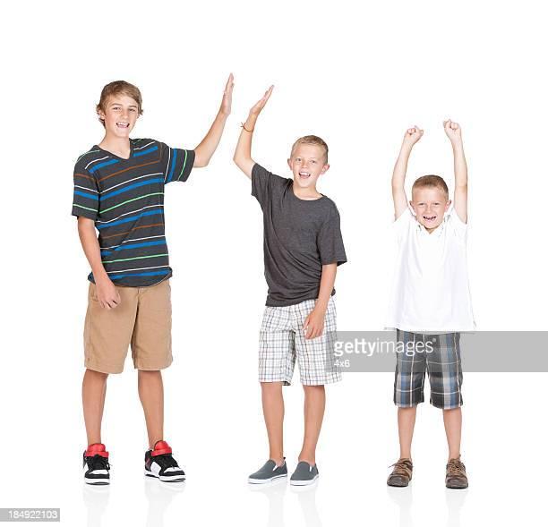 Portrait of three boys cheering