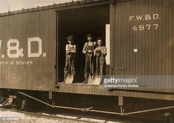 Portrait of Three Boys that Shovel Zinc Ore from Car Into Wagon Near Big Bonanza Mine Aurora Missouri USA circa 1910