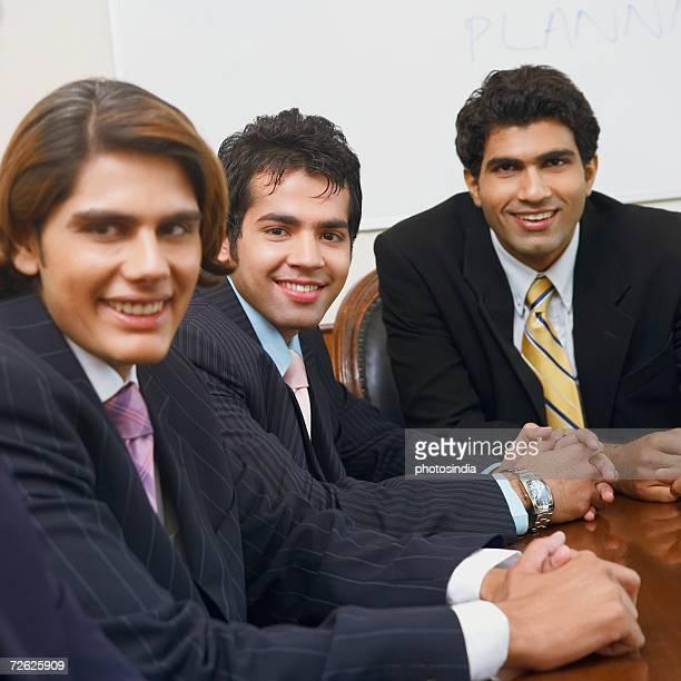 Portrait of three businessmen smiling