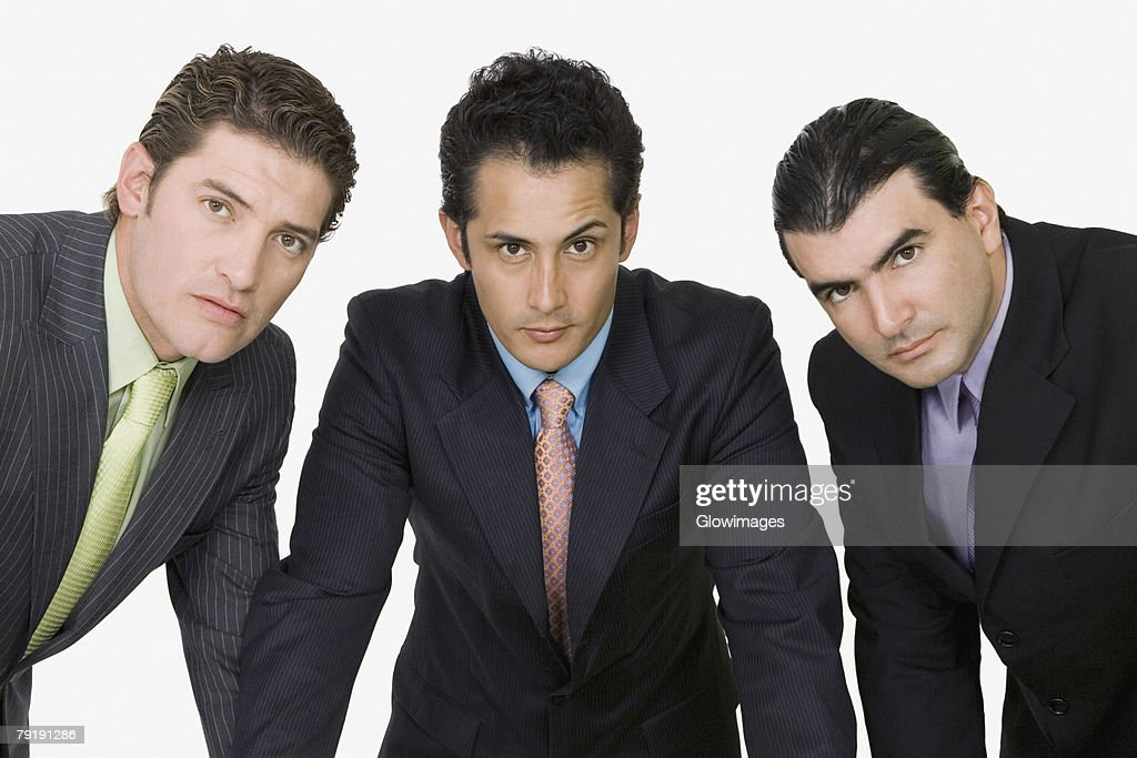 Portrait of three businessmen standing together : Foto de stock