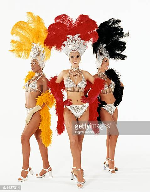 Portrait of Three Chorus Girls Standing with Their Hands on Their Hips and Wearing Full Stage Costume