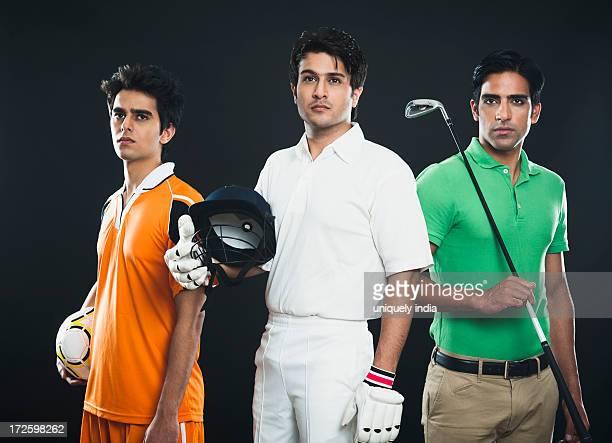 Portrait of three different sportsmen