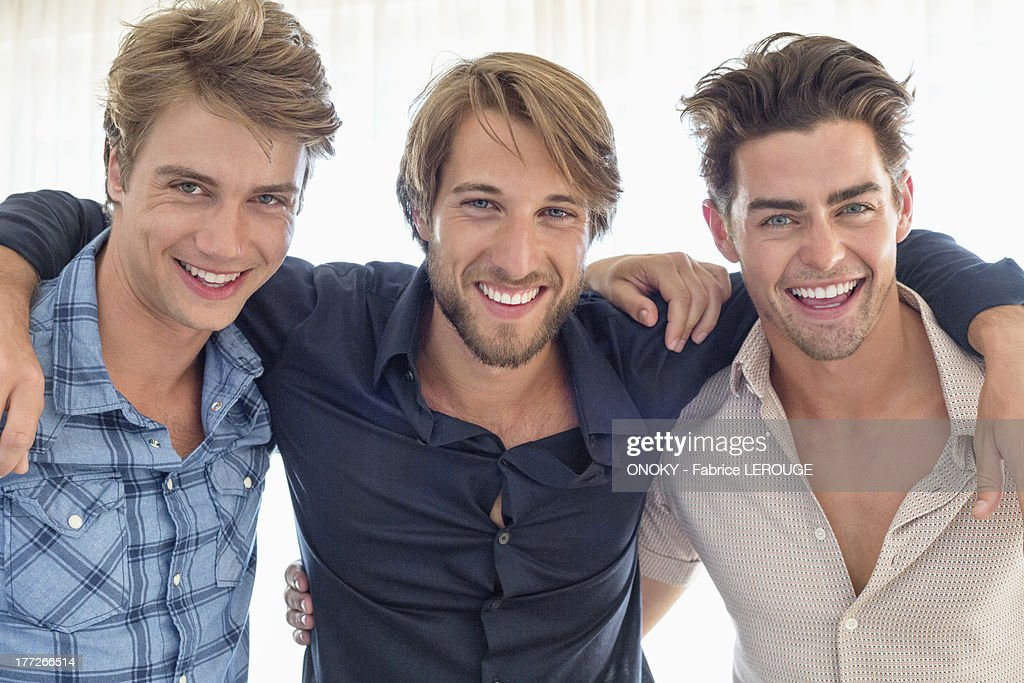 Portrait of three friends smiling together : Stock Photo