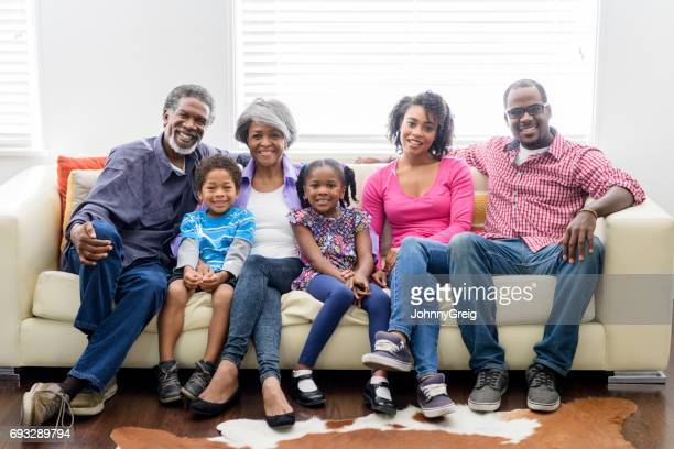 Portrait of three generation African American family on sofa