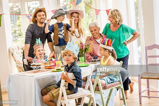 Portrait of three generation family at kids birthday party