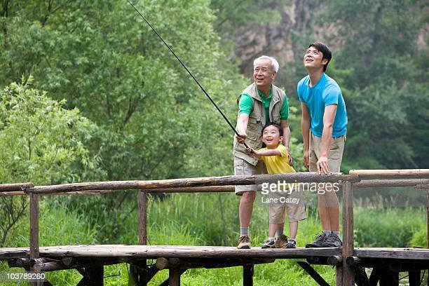 Portrait of three generations fishing