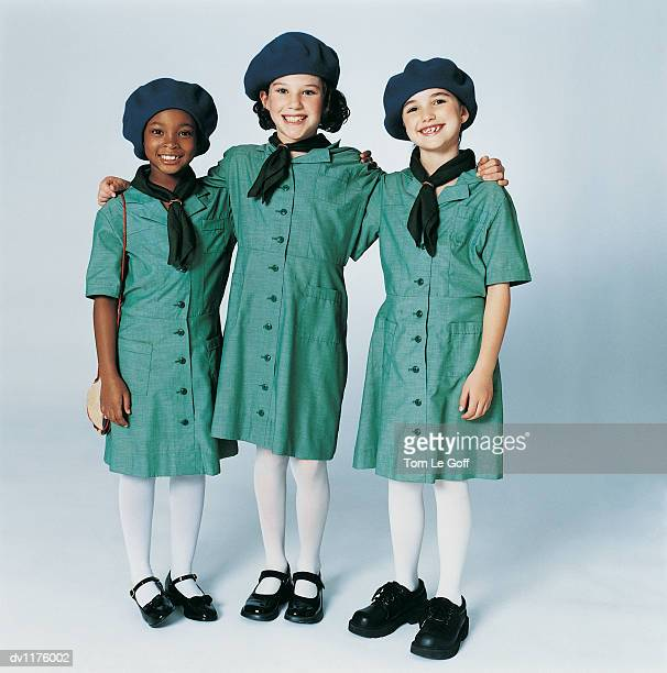 Portrait of Three Girl Guides Standing in a Line With their Arms Around Each Other