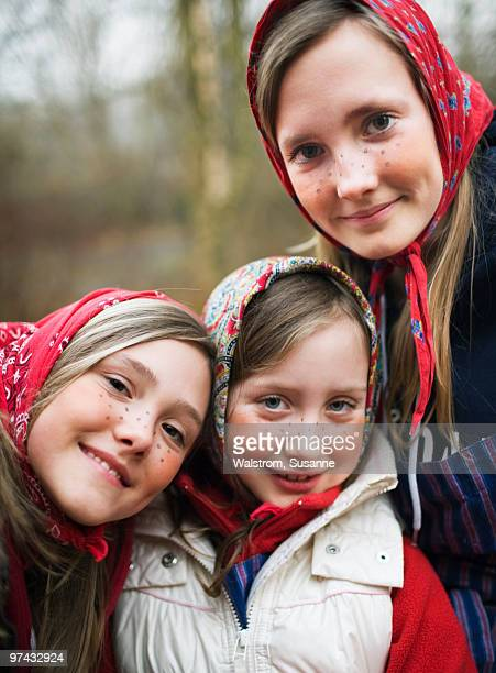 Portrait of three girls dressed up as Easter witches, Sweden.