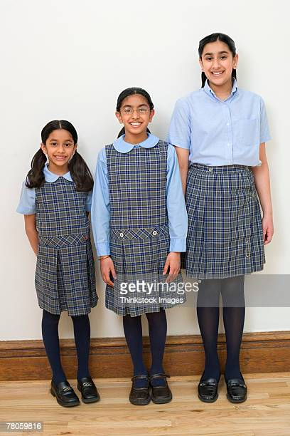 Portrait of three girls in school uniform