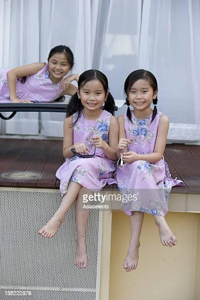 Portrait of three girls smiling