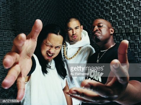Portrait of Three Rapper Standing in a Recording Studio