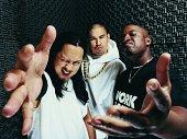 Portrait of Three Rapper Standing in a Recording Studio