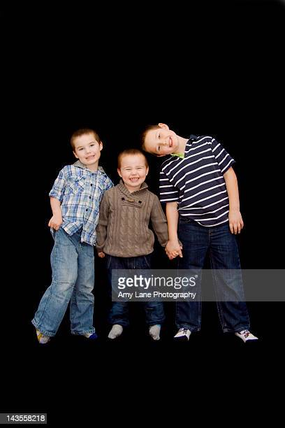 Portrait of three smiling brothers
