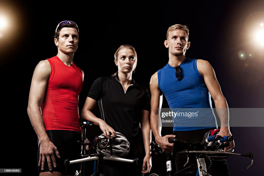 portrait of three triathletes with cycles : Stock Photo