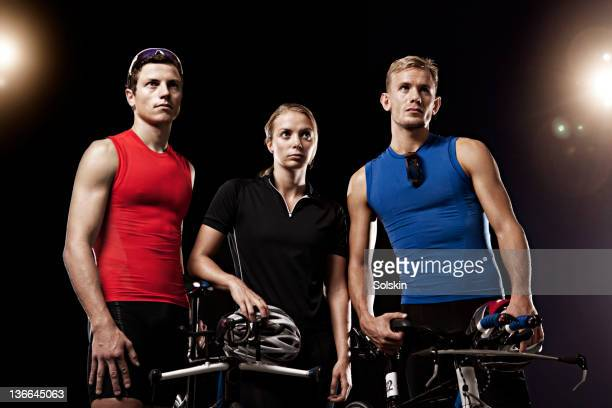 portrait of three triathletes with cycles