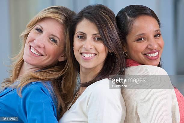 Portrait of three women smiling