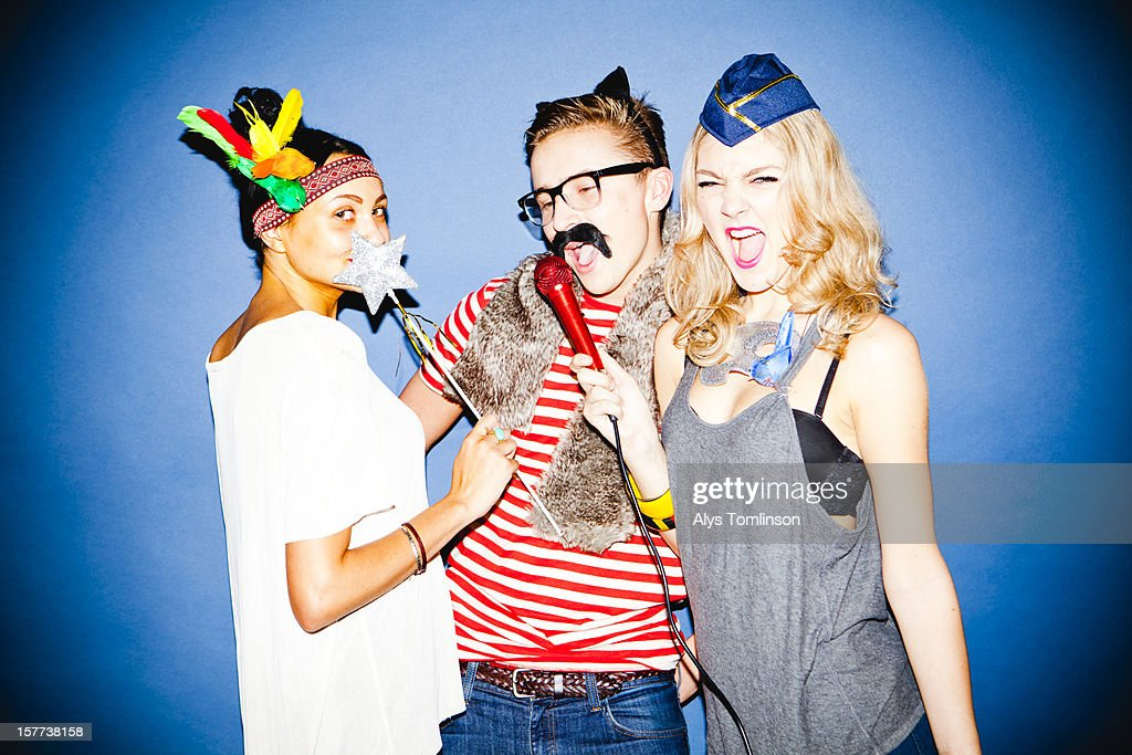 Portrait of three young people in fancy dress : Stock Photo