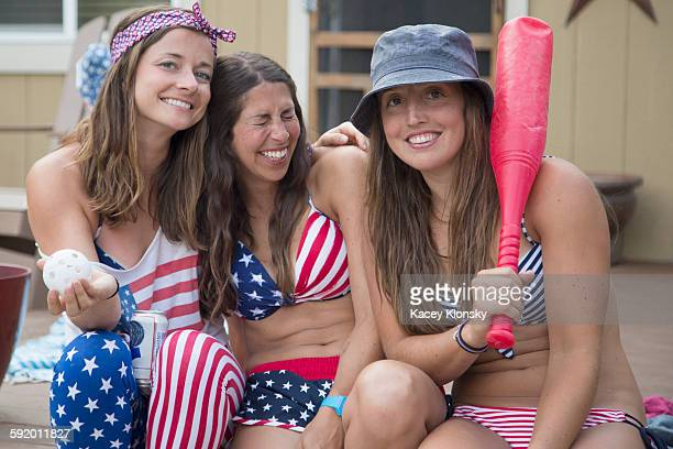 Portrait of three young women wearing American flag costume celebrating Independence Day, USA