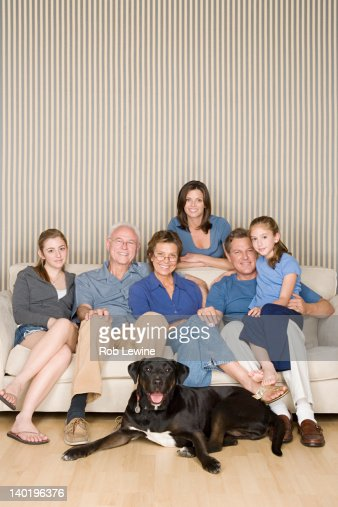 Portrait of three-generation family with two girls (8-9, 14-15) and dog : Stock Photo