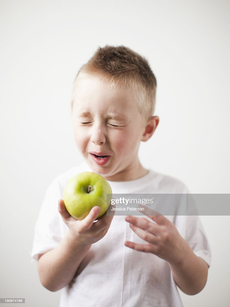 Portrait of toddler boy (2-3) playing with green apple : Stock Photo