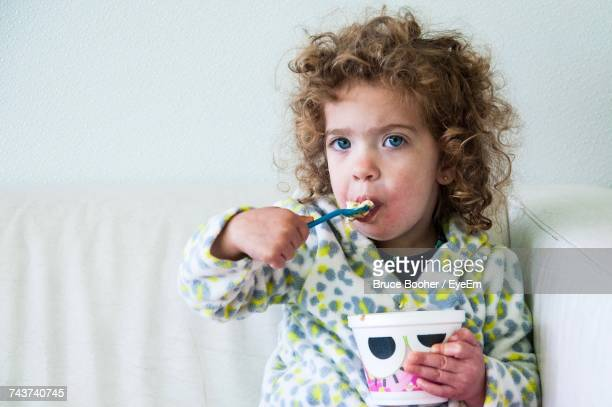 Portrait Of Toddler Eating At Home