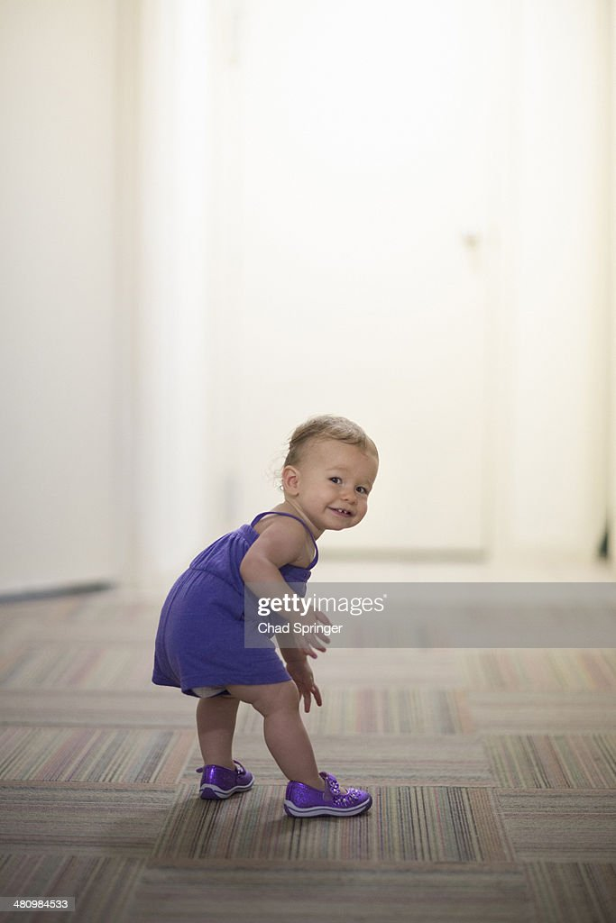 Portrait of toddler girl wearing purple clothes : Stock Photo