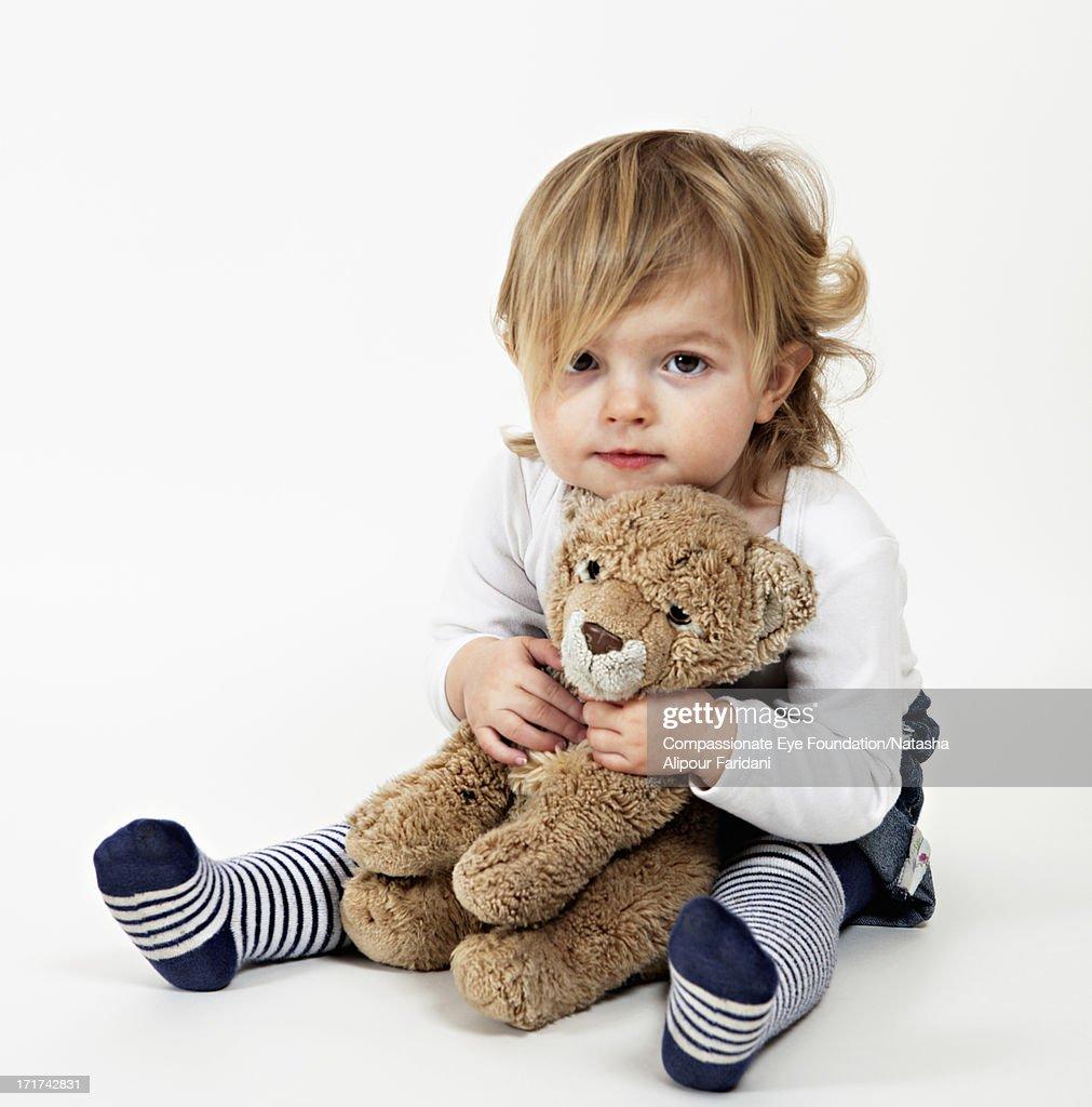 Portrait of toddler holding teddy bear