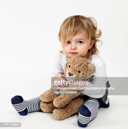 Portrait of toddler holding teddy bear : Stock Photo