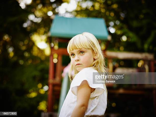 Portrait of toddler standing in front of playset