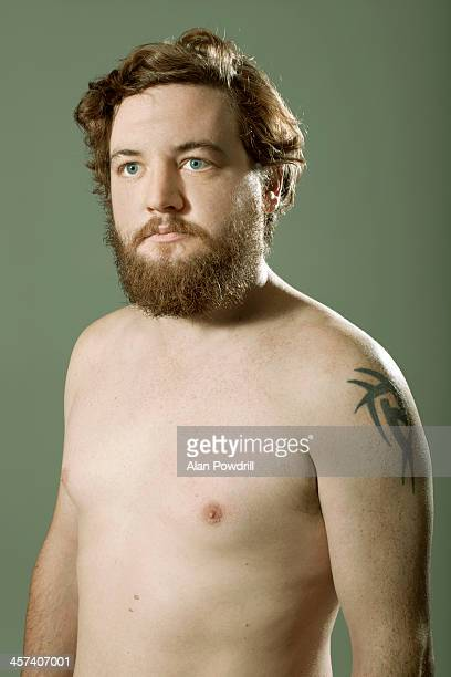 Portrait of topless man with beard