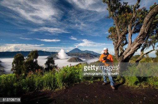 Portrait of tourist with volcano at background