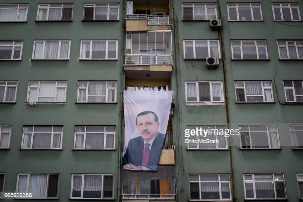 A portrait of Turkish President Recep Tayyip Erdogan is seen hanging from a balcony on an apartment block on April 7 2017 on the outskirts of Fatsa...