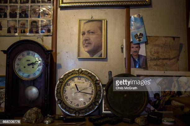 A portrait of Turkish President Recep Tayyip Erdogan is seen hanging in a vinatge store in the old city on April 13 2017 in Gaziantep Turkey...
