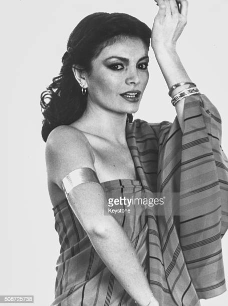 Portrait of Turkish singer Ajda Pekkan soon appearing at the Eurovision Song Contest wearing traditional dress and bangles March 17th 1980
