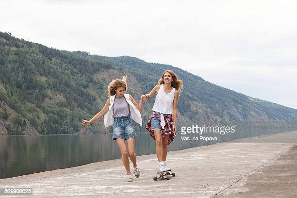 Portrait of twins with skateboard