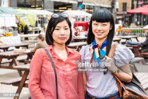 Portrait of two asian women at urban market. : Photo