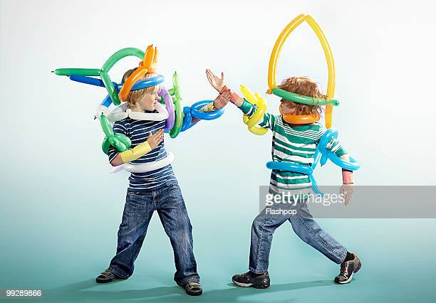 Portrait of two boys playing in fancy dress