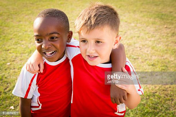 Portrait of two boys wearing football shirts with