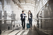 Portrait of two business people meeting before go to traveling. Business travel concept
