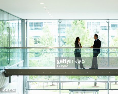 Portrait of two business people talking : Stock Photo