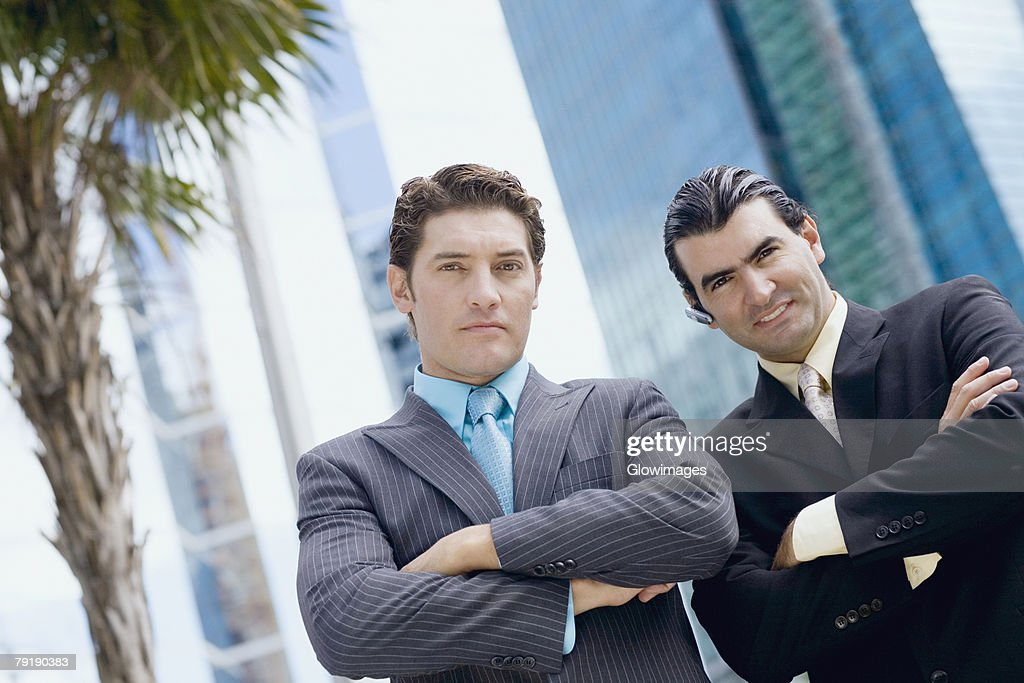 Portrait of two businessmen standing with their arms crossed : Foto de stock