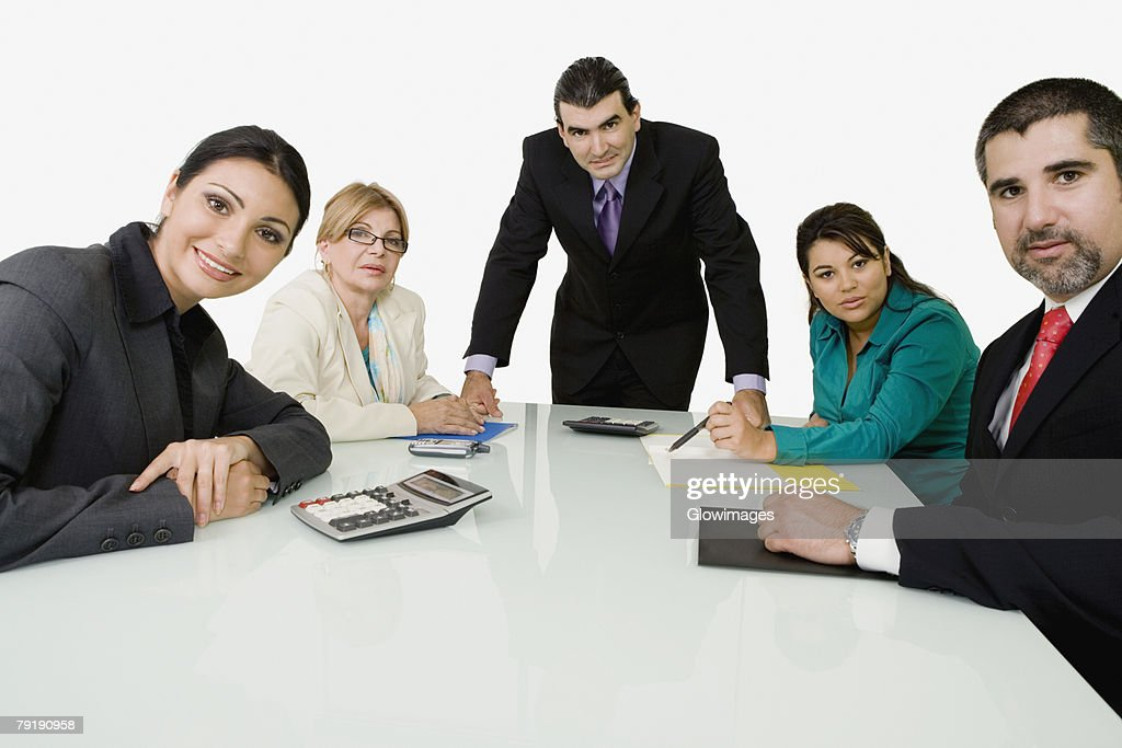 Portrait of two businessmen with three businesswomen in an office