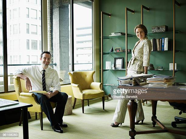 Portrait of two businesspeople in office