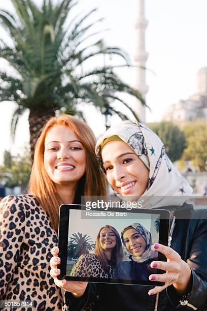Portrait Of Two Cheerful Women Taking Selfies In Istanbul