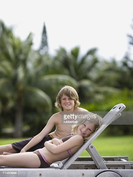 Portrait of two children reclining and smiling