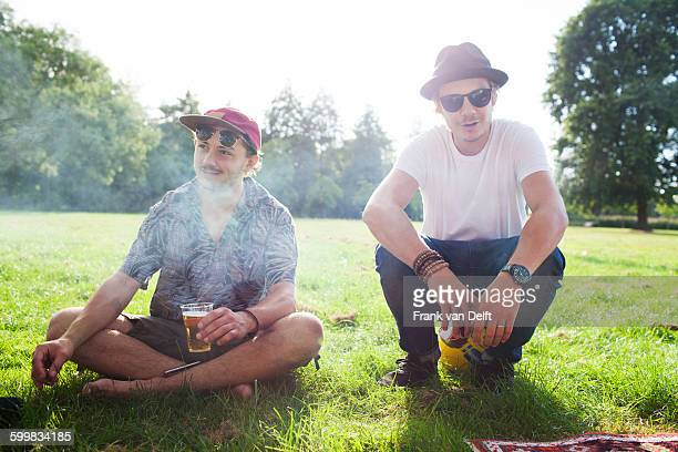 Portrait of two cool male friends at park party