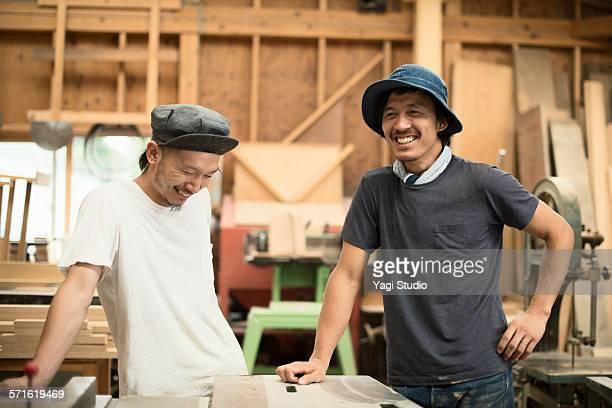 Portrait of two craftsmen in workshop